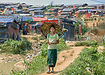 A girl walks through the Jamtoli Refugee Camp near Cox's Bazar, Bangladesh. More than 600,000 Rohingya refugees have fled government-sanctioned violence in Myanmar for safety in this and other camps in Bangladesh.