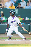 Tim Anderson (7) of the Winston-Salem Dash follows through on his swing against the Carolina Mudcats at BB&T Ballpark on June 6, 2014 in Winston-Salem, North Carolina.  The Mudcats defeated the Dash 3-1.  (Brian Westerholt/Four Seam Images)