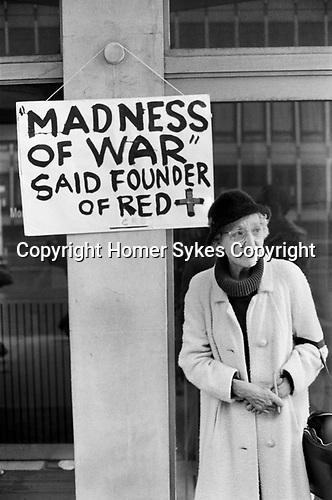 Senior woman lone protest against the Falkland war demo London UK. May 1983