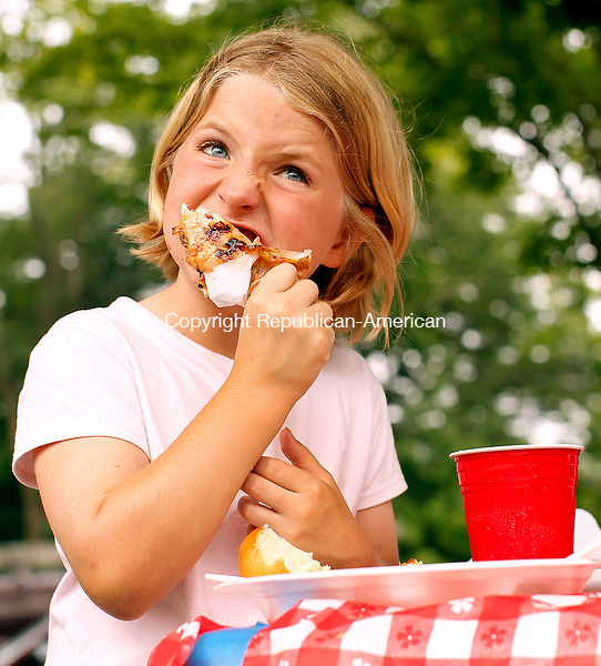 Middlebury, CT-27, June 2010-062710CM01  Sofia Pattillo, 8, of Middlebury enjoys a piece BBQ chicken Sunday afternoon at the 54th annual Middlebury Congregational Church picnic.  The picnic featured BBQ chicken, baked beans, coleslaw , lemonade and strawberry shortcake.  --Christopher Massa Republican-American