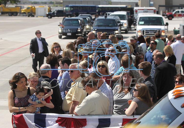 The crowd waits for President Barack Obama to land in Reno, Nev. on Friday, May 11, 2012. (AP Photo/Cathleen Allison)