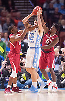 NWA Democrat-Gazette/J.T. WAMPLER Arkansas' Manuale Watkins (left) and Jaylen Barford cover North Carolina's Luke Maye Sunday March 19, 2017 during the second round of the NCAA Tournament at the Bon Secours Wellness Arena in Greenville, South Carolina. The Tar Heels beat the Razorbacks 72-65 eliminating them from the tournament.