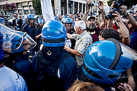 Rome, Italy  September 03, 2015<br /> Demostration anti-mafia, called by the centre-left Democratic Party,  at the church of Don Bosco in Rome to protest the ostentatious funeral of the purported Italian crime boss, Vittorio Casamonica, and to take a public stand against Italy's powerful crime syndicates. The Caravan of the Suburbs and the union Asia-USB, against the Democratic Party during the demonstration against the mafia, shouting&quot; Mafia Capital is within you. &quot;. Protesters with the photo of the dinner with members of the center-right of the center-left, with Casamonica. The police seized the photos of the dinner.