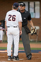 Virginia Cavaliers head coach Brian O'Connor #26 argues a call with home plate umpire Jeff Henrichs in the championship game of the Charlottesville Regional at Davenport Field on June 7, 2010, in Charlottesville, Virginia.  The Cavaliers defeated the Red Storm 5-3.  Photo by Brian Westerholt / Four Seam Images
