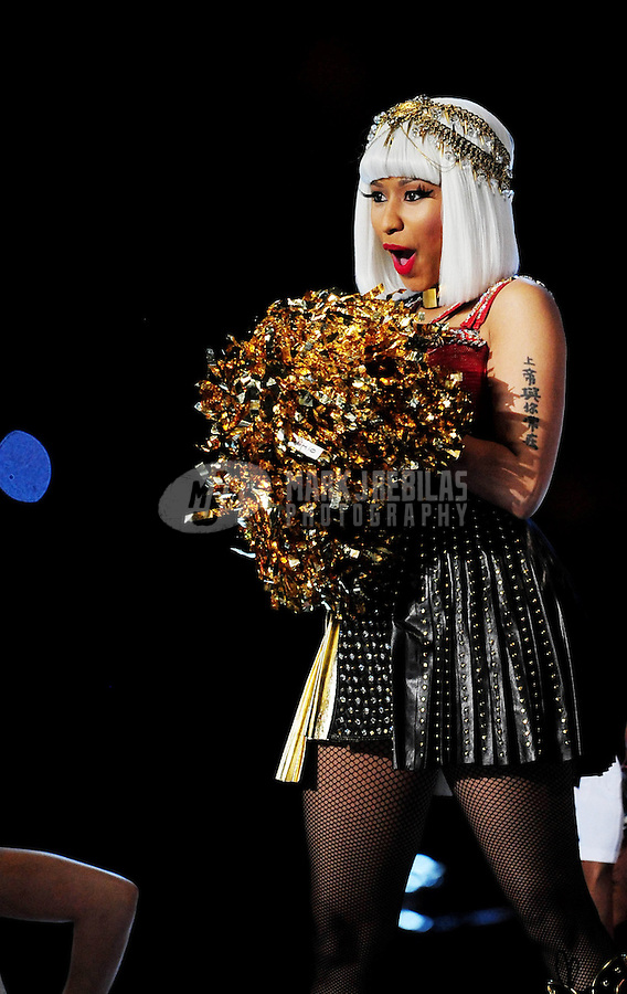 Feb 5, 2012; Indianapolis, IN, USA; Recording artists Nicki Minaj performs with Madonna (not pictured) during the halftime show for Super Bowl XLVI between the New York Giants and New England Patriots at Lucas Oil Stadium.  Mandatory Credit: Mark J. Rebilas-