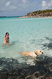EXUMA, Bahamas. Nicole and Ruby, playing on the beach of Compass Cay.