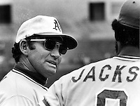 A's manager Alvin Dark talking to Reggie Jackson.(1974 copyright  Ron Riesterer).