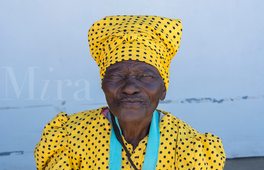 Namibia Africa near Windhoek portraits of older local Herero Tribe woman in colorful dress and hat