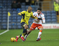 Blackpool's Kelvin Mellor battles with Oxford United's Wes Thomas<br /> <br /> Photographer Mick Walker/CameraSport<br /> <br /> The EFL Sky Bet League One - Oxford United v Blackpool - Saturday 6th January 2018 - Kassam Stadium - Oxford<br /> <br /> World Copyright &copy; 2018 CameraSport. All rights reserved. 43 Linden Ave. Countesthorpe. Leicester. England. LE8 5PG - Tel: +44 (0) 116 277 4147 - admin@camerasport.com - www.camerasport.com
