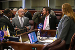 """From left, Nevada Assembly members Jason Frierson, D-Las Vegas, Ira Hansen, R-Sparks, David Bobzien, D-Reno, and Maggie Carlton, D-Las Vegas, talk on the Assembly floor during the second day of a special session at the Nevada Legislature, in Carson City, Nev., on Thursday, Sept. 11, 2014. Hansen called the complex deal to bring Tesla Motors to Nevada """"arguably the biggest thing that has happened in Nevada since at least the Hoover Dam."""" (AP Photo/Cathleen Allison)"""