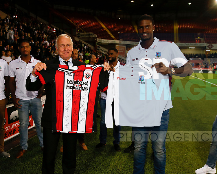 Chairman Kevin McCabe and West Indies captain Jason Holder swap shirts during the Carabao Cup, second round match at Bramall Lane, Sheffield. Picture date 22nd August 2017. Picture credit should read: Simon Bellis/Sportimage