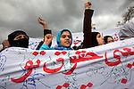 Afghan women hold banners during a demonstration at the national Parliament compound in Kabul, Afghanistan, Wednesday morning, Apr. 15, 2009. Around 200 women gathered for the demonstration, then marched to Parliament to protest the Shia Personal Status Law, which was signed by Afghan President Hamid Karzai last month. Critics and women's activists say the law legalizes marital rape and violates women's basic human rights.