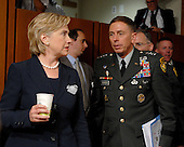 Washington, D.C. - September 11, 2007 -- United States Senator Hillary Rodham Clinton (Democrat of New York) shares some thoughts with United States Army General David H. Petraeus, Commander of the Multi-National Force - Iraq (MNF-I), as they arrive for the hearing of the United States Senate Armed Services Committee on the future course of the war in Iraq, Tuesday, September 11, 2007, on Capitol Hill in Washington..Credit: Ron Sachs / CNP.(RESTRICTION: NO New York or New Jersey Newspapers or newspapers within a 75 mile radius of New York City)
