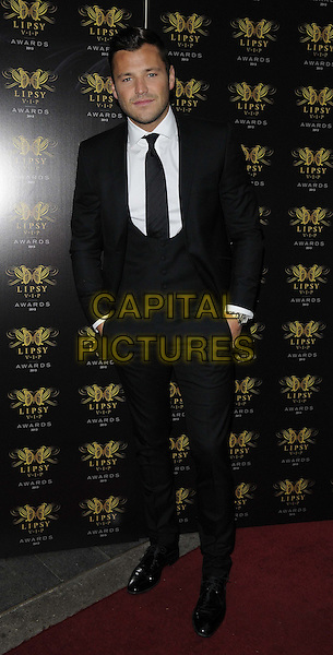 Mark Wright<br /> The Lipsy VIP Fashion Awards 2013, DSTRKT, Rupert St., London, England.<br /> May 29th, 2013<br /> full length black white suit waistcoat shirt tie hands in pockets <br /> CAP/CAN<br /> &copy;Can Nguyen/Capital Pictures