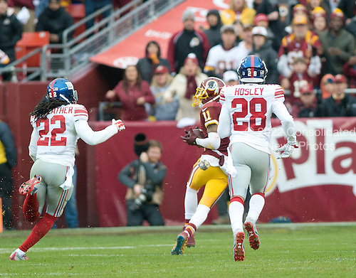 Washington Redskins wide receiver DeSean Jackson (11) catches a 63 yard touchdown pass between New York Giants strong safety Brandon Meriweather (22) and cornerback Jayron Hosley (28) in the second quarter at FedEx Field in Landover, Maryland on Sunday, November 29, 2015.<br /> Credit: Ron Sachs / CNP<br /> (RESTRICTION: NO New York or New Jersey Newspapers or newspapers within a 75 mile radius of New York City)