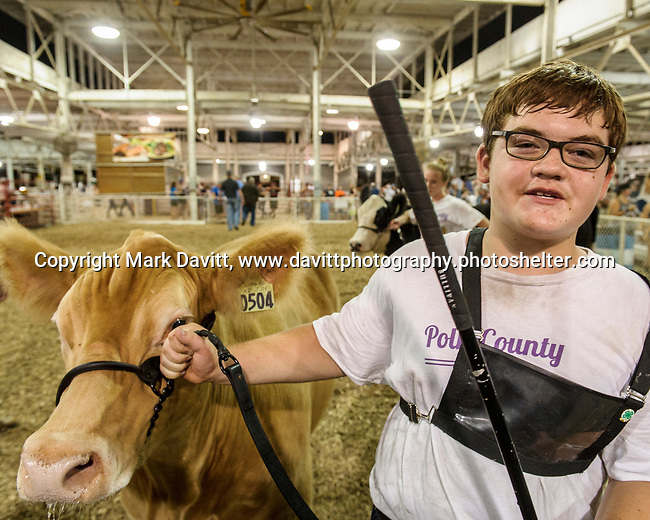 Dawson Minor of Plowshare 4H Club of Bondurant leaves the show ring with a smile on his face after his steer was declared Grand Champion Market Steer at the Polk County Fair July 21.He is the son of son of Kerri and Andy Minor.