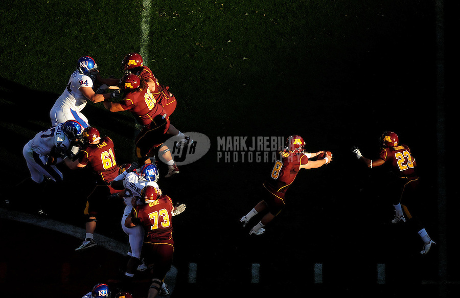 Dec. 31, 2008; Tempe, AZ, USA; Kansas Jayhawks quarterback (8) Adam Weber fakes a hand off to running back (23) DeLeon Eskridge in the first quarter against the Minnesota Golden Gophers during the Insight Bowl at Sun Devil Stadium. Mandatory Credit: Mark J. Rebilas-