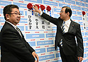 July 10, 2016, Tokyo, Japan - President Kazuo Shii of the Japanese Communist Party pins a red rose on the name of a Communist candidate at the party headquarters in Tokyo following Sundays upper house election on July 10, 2016. Party Secretary-General Akira Koike is at left. A field 389 candidates, including 42 from the Communist Party, across the country vied for half of the Diet upper chambers 242 seats in the triennial election.Prime Minister Shinzo Abes ruling coalition won a landslide victory despite doubts about his economic policies and his goal of revising the pacifist constitution.?(Photo by Natsuki Sakai/AFLO) AYF -mis-