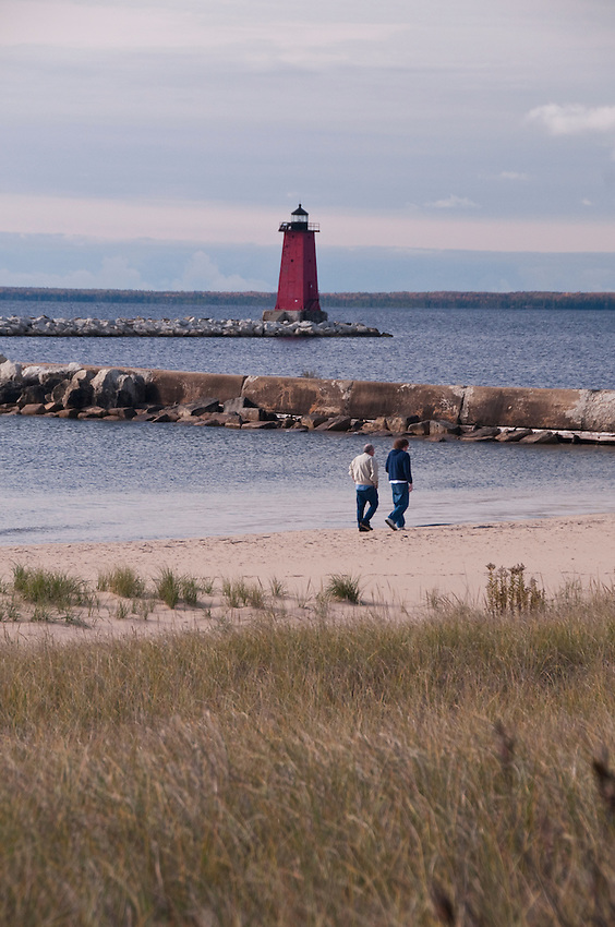 Manistique Lighthouse and Lake Michigan beach in Manistique Michigan.