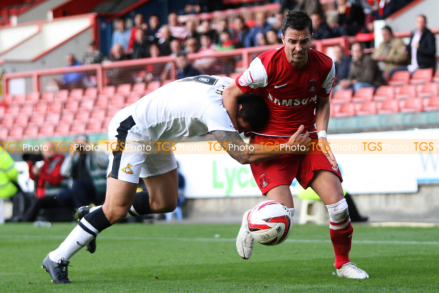 Billy Paynter of Doncaster Rovers holds on to Leon McSweeney of Leyton Orient - Leyton Orient vs Doncaster Rovers - NPower League One Football at the Matchroom Stadium, Brisbane Road, London - 29/09/12 - MANDATORY CREDIT: George Phillipou/TGSPHOTO - Self billing applies where appropriate - 0845 094 6026 - contact@tgsphoto.co.uk - NO UNPAID USE.