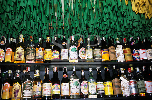 Rio de Janeiro, Brazil. Collection of cachaca (sugar cane alcohol) bottles on display; bar Academia da Cachaca, Leblon.