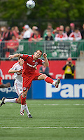 16 May 09: Chicago Fire defender Brandon Prideaux #6 and Toronto FC forward Chad Barrett #19 in action at BMO Field during a game between the Chicago Fire and Toronto FC..Chicago Fire won 2-0..