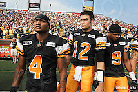 September 7, 2009; Hamilton, ON, CAN; Hamilton Tiger-Cats wide receiver Arland Bruce III (4) quarterback Quinton Porter (12) defensive back Geoff Tisdale (9). CFL football - the Labour Day Classic - Toronto Argonauts vs. Hamilton Tiger-Cats at Ivor Wynne Stadium. The Tiger-Cats defeated the Argos 34-15. Mandatory Credit: Ron Scheffler.