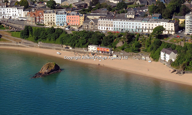 """Pictured: The row of properties where Croft House is located in Tenby, west Wales.<br /> Re: A holiday home where Beatrix Potter drew parts of The Tale of Peter Rabbit is up for sale.<br /> The renowned author wrote a letter from the seaside home in Tenby, Pembrokeshire, in 1900 telling tales of rabbits living in the cliffs.<br /> She was also inspired by the garden of the Grade II-listed Georgian property and painted a lily pond that was used in the book.<br /> Croft House has been put on the market for £1.8m.<br /> The building was once split into two houses - with Potter staying at number two.<br /> Andrew Lowe, whose family have owned the property since 1964, said that in 1900 Ms Potter wrote four 'Tenby letters' to the children of governess Annie Moore.<br /> """"She also did two paintings of the garden of Croft House, no longer part of the property,"""" he continued.<br /> """"The lily pond illustration that appears in The Tale of Peter Rabbit was taken from one of these paintings."""""""
