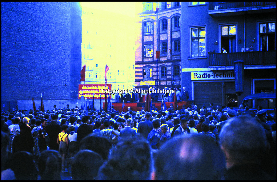 BNPS.co.uk (01202 558833)<br /> Pic: AllanHailstone/BNPS<br /> <br /> Communist Rally in East Berlin in 1959.<br /> <br /> New book reveals unseen pictures of the bleak landscape of Cold War Berlin.<br /> <br /> The remarkable photos were taken by a British visitor before and after the Berlin Wall was built in 1961.<br /> <br /> Retired coin dealer Allan Hailstone visited Berlin several times between 1959 and 1966 and took hundreds of photos of both West Berlin and East Berlin.<br /> <br /> The 78 year old was struck by the stark contrast between the vibrant, colourful West Berlin he encountered and rubble-filled, sparse East Berlin.<br /> <br /> During his first visit to Berlin in 1959, Mr Hailstone was able to walk freely between the two sides of the city, but this changed when he returned in 1962 as the Berlin Wall had been built to stop east Berliners from escaping to the west.