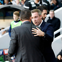 Neil Harris manager of Millwall greets Steve Cotterill, manager of Birmingham City during the Sky Bet Championship match between Millwall and Birmingham City at The Den, London, England on 21 October 2017. Photo by Carlton Myrie.