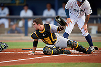 Bradenton Marauders catcher Jason Delay (5) shows the umpire the baseball after being run over by Robbie Tenerowicz (1) on a play at the plate during a game against the Charlotte Stone Crabs on August 6, 2018 at Charlotte Sports Park in Port Charlotte, Florida.  Charlotte defeated Bradenton 2-1.  (Mike Janes/Four Seam Images)