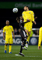 Joseph Ngwenya (11) of D.C. United goes up for a header with Dejan Rusmir (22) of the Columbus Crew during the home opener at RFK Stadium in Washington D.C.  D.C. United defeated the Columbus Crew, 3-1.