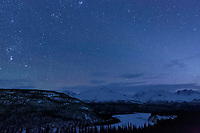 Winter landscape showing Matanusaka River and Chugach Mountains with stars in sky at dusk   February 2016