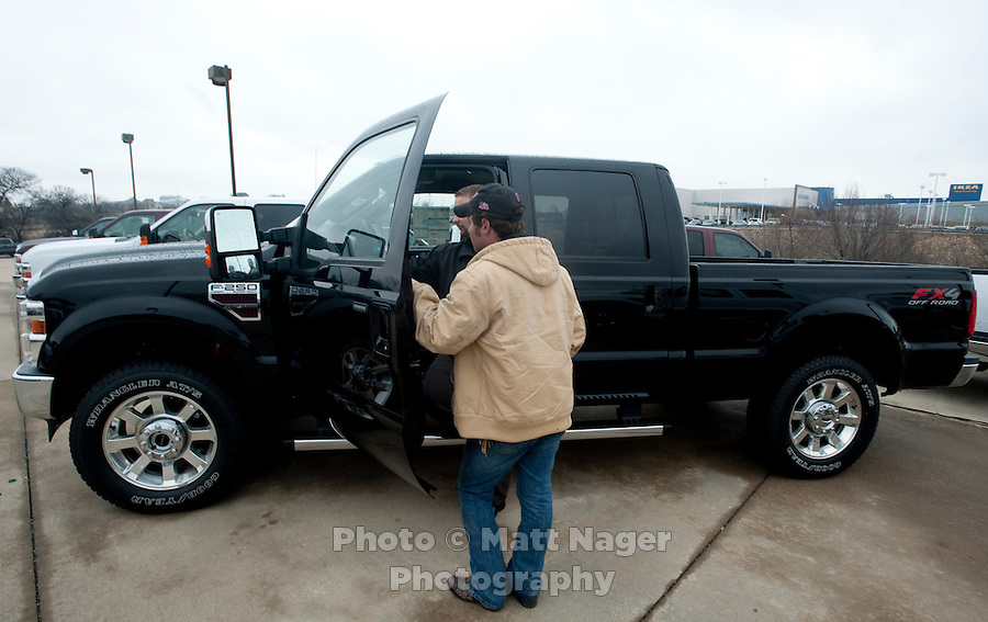 Carl Tanner (cq, left) and Sales Consultant Scott Alter, Jr. (cq) check out a new F250 Ford truck at Bankston Ford in Frisco, Texas, Thursday, Jan., 28, 2009. Ford reported gains in earnings for the first time in four years...PHOTOS/ Matt Nager