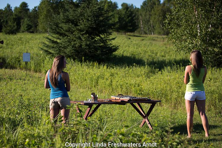 Woman shooting handguns