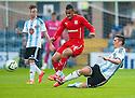 Hearts' Jamie Walker challenges Dundee's Philip Roberts.