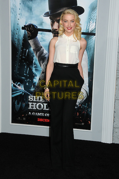 Amber Heard.The World Premiere of 'Sherlock Holmes: A Game of Shadows' held at The Village Theatre in Brentwood, California, USA..December 6th, 2011.full length white sleeveless shirt black trousers gold bracelet hand in pocket .CAP/ADM/BP.©Byron Purvis/AdMedia/Capital Pictures.