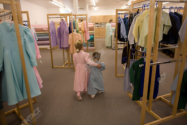 "Fundamentalist Mormon group F.L.D.S.,  girls looking through clothing section of the Storehouse on the ""Yearning for Zion"" compound in Eldorado, Texas, USA, February 12, 2009"
