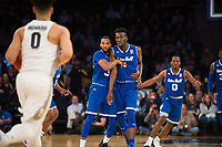 NEW YORK, NY - Thursday March 9, 2017: Madison Jones (#30) of Seton Hall and Eron Gordon (#4) of Seton Hall in transition against Marquette as the two schools square off in the Quarterfinals of the Big East Tournament at Madison Square Garden.