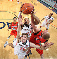 Virginia's Mike Scott(32) grabs the rebound in front of Texas Pan Am defenders during the 72-53 win Tuesday night at the John Paul Jones Arena in Charlottesville, Va. Photo/Andrew Shurtleff