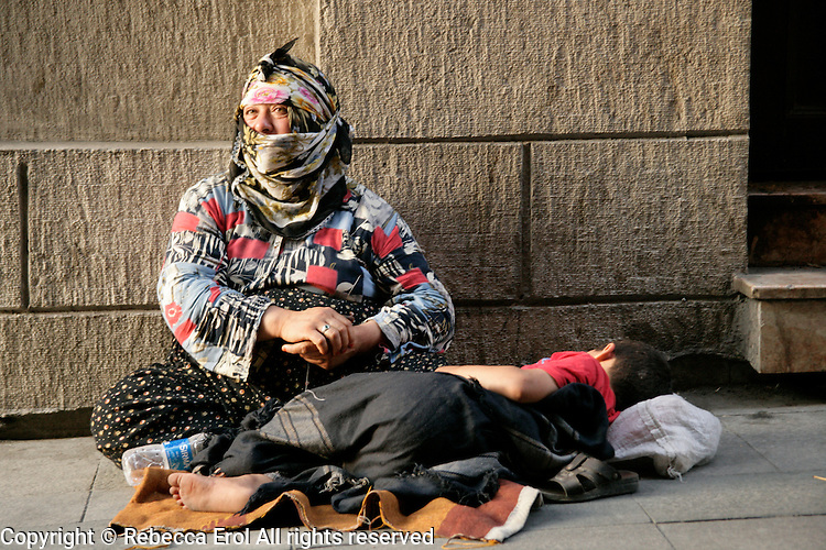 Gypsy woman begging on the streets of Istanbul, Turkey
