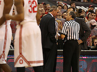 OSU head coach Thad Matta confers with referees following a skirmish in the second half of their game against the Northwestern Wildcats at the Value City Arena in Columbus, Ohio on February 19, 2014. (Columbus Dispatch photo by Brooke LaValley)