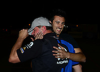 Nov. 11, 2012; Pomona, CA, USA: NHRA Vincent Nobile (right) congratulates pro stock driver Allen Johnson who celebrates after winning the Auto Club Finals at at Auto Club Raceway at Pomona. Mandatory Credit: Mark J. Rebilas-