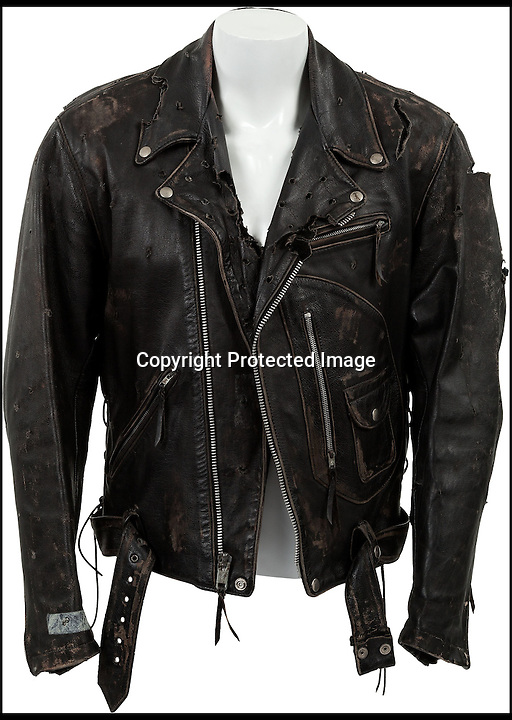 BNPS.co.uk (01202 558833)<br /> Pic: Heritage/BNPS<br /> <br /> ***Please Use Full Byline***<br /> <br /> The bullet-ridden biker jacket worn by Hollywood star Arnold Schwarzenegger as killer cyborg the Terminator is up for sale for &pound;10,000 <br /> <br /> Arnie donned the custom-made black leather jacket for his return to the classic role in the 1991 blockbuster smash Terminator 2: Judgement Day.<br /> <br /> The jacket is peppered with 'bullet holes' from a shoot-out with a rival cyborg early in the film as heroine Sarah Connor escapes from a hospital.<br /> <br /> It is being sold by Ron South, the film's second assistant director, who was given it when the production finished.<br /> <br /> It has been tipped to fetch upwards of 10,000 pounds when it goes under the hammer at Heritage Auctions in Dallas, Texas, on December 6.