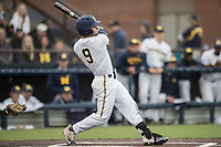 Michigan Wolverines shortstop Michael Brdar (9) follows through on his swing against the Michigan State Spartans on May 19, 2017 at Ray Fisher Stadium in Ann Arbor, Michigan. Michigan defeated Michigan State 11-6. (Andrew Woolley/Four Seam Images)
