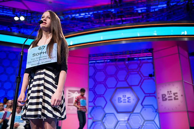 Speller No. 067, Sophie Bergman, 13, seventh grader at Morning Star Academy, Bettendorf, Iowa, competes in the preliminary rounds of the Scripps National Spelling Bee at the Gaylord National Resort and Convention Center in National Habor, Md., on Wednesday, May 29, 2013. Photo by Bill Clark