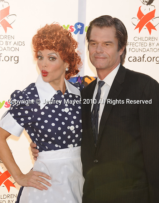 SANTA MONICA, CA. - October 30: Lisa Rinna and Harry Hamlin arrive at the 17th Annual Dream Halloween CAAF Benefit at Barker Hangar on October 30, 2010 in Santa Monica, California.
