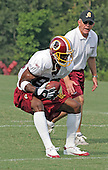 Washington Redskins wide receiver Darnarian McCants (85) makes a catch during passing drills under the watchful eyes of head coach Joe Gibbs during the first day of the 2005 Training Camp at Redskins Park in Ashburn, Virginia on August 1, 2005.  <br /> Credit: Arnie Sachs / CNP