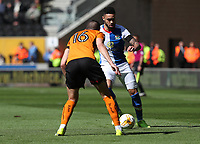 Blackburn Rovers' Derrick Williams is tackled by Wolverhampton Wanderers' Conor Coady<br /> <br /> Photographer Rachel Holborn/CameraSport<br /> <br /> The EFL Sky Bet Championship - Wolverhampton Wanderers v Blackburn Rovers - Saturday 22nd April 2017 - Molineux - Wolverhampton<br /> <br /> World Copyright &copy; 2017 CameraSport. All rights reserved. 43 Linden Ave. Countesthorpe. Leicester. England. LE8 5PG - Tel: +44 (0) 116 277 4147 - admin@camerasport.com - www.camerasport.com