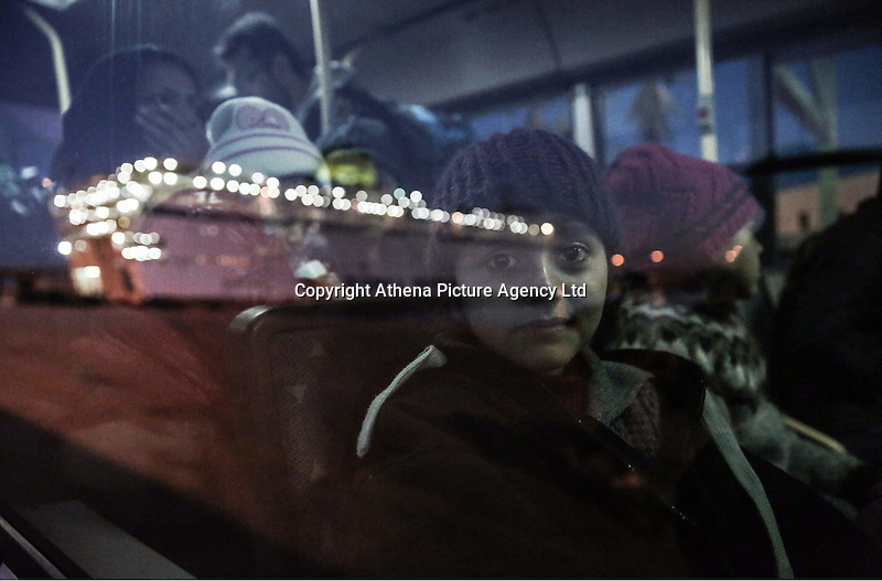 Pictured: Young migrant children on the transfer bus Monday 22 February 2016<br /> Re: Thousands of migrants, most from Syria, have landed to the port of Pireaus, after crossing the border from Turkey to various islands like Lesvos and Kos in Greece.